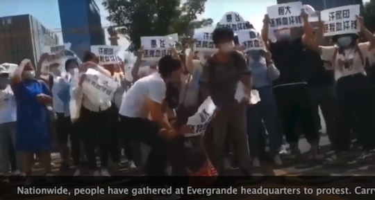"""Courtesy: YouTube """"Evergrande, return our hard-earned money,"""" protesters chant."""